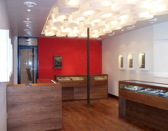 Photograph of custom jewelry display cases and inset wall displays by Townsend Design for Me&Ro Jewelry, Elizabeth St., NYC. Design: SHoP Architects